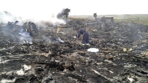 All 295 passengers and crew are believed dead as a Malaysian airliner crashes in the east Ukraine conflict zone, amid claims of a missile attack.